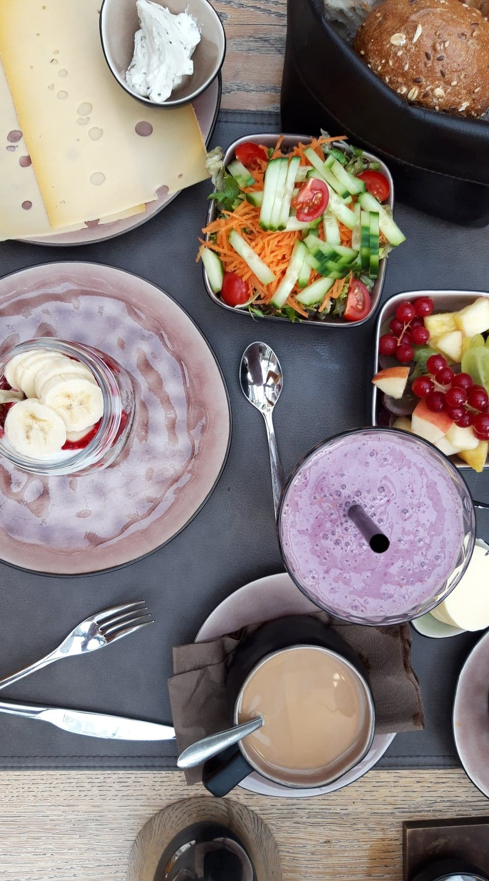 brunch: salad, fruit salad, yoghurt with fruit, coffee and smoothie