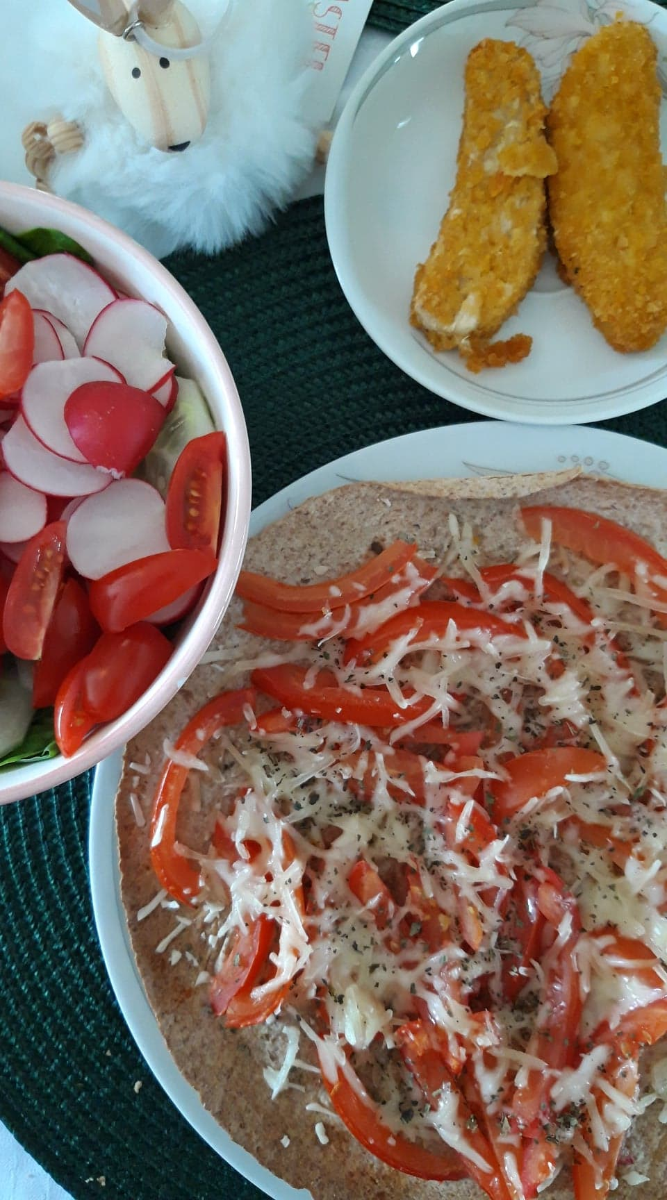 Salad, faux chicken and pizza made of wraps, tomatoes and faux mozzarella