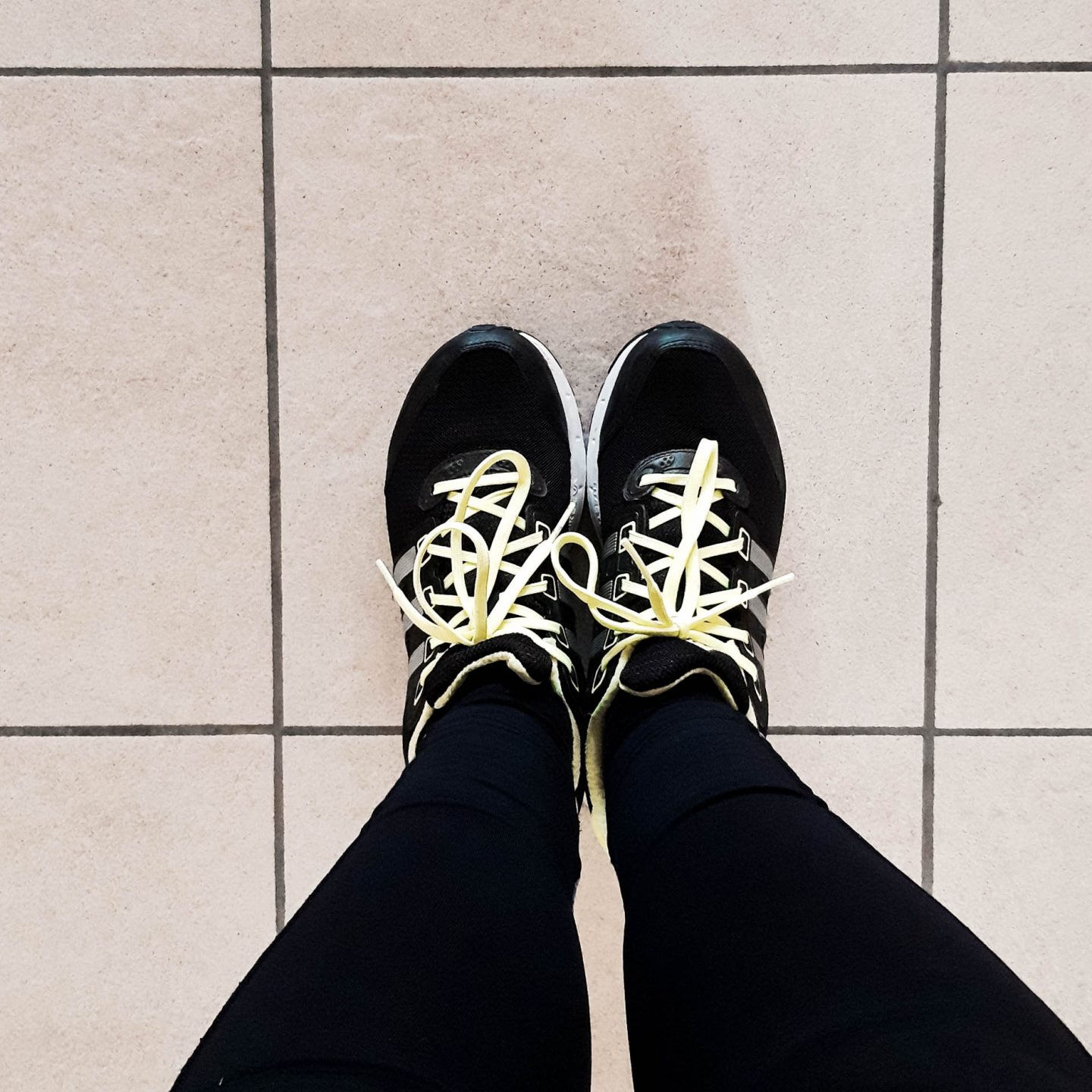 Ready to workout with workout shoes and leggings